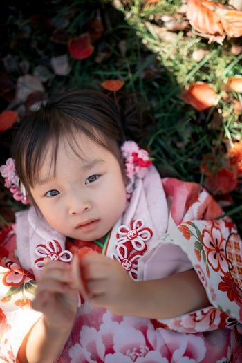 High angle portrait of cute girl with flowers