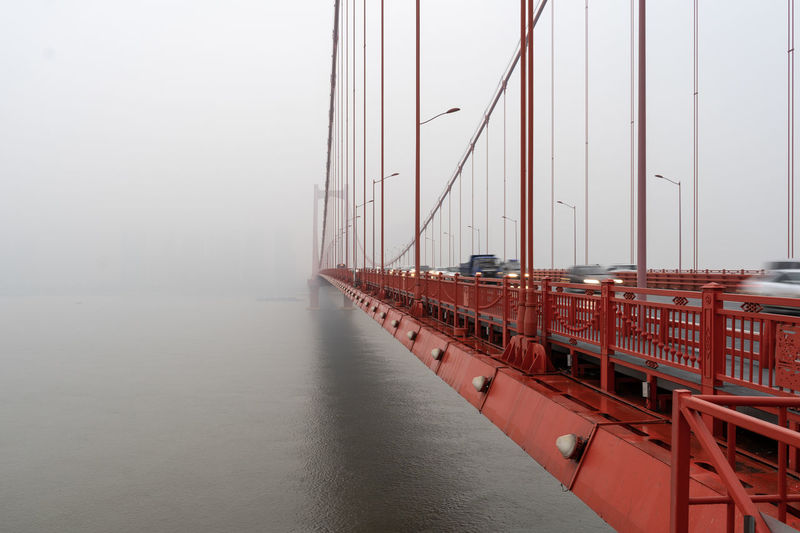 Architecture Bay Beauty In Nature Bridge Bridge - Man Made Structure Built Structure Connection Day Fog Mode Of Transportation Nature Nautical Vessel No People Outdoors Sailboat Sea Sky Suspension Bridge Transportation Water