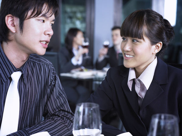 business couple working as team have lunch together Business Businessman Businesswoman Colleague Corporate Business Coworker Focus On Foreground Food And Drink Freshness Friendship Happiness Hotel Indoors  Lunch Meeting Men Necktie Occupation Real People Refreshment Restaurant Smiling Teamwork Well-dressed Women Working