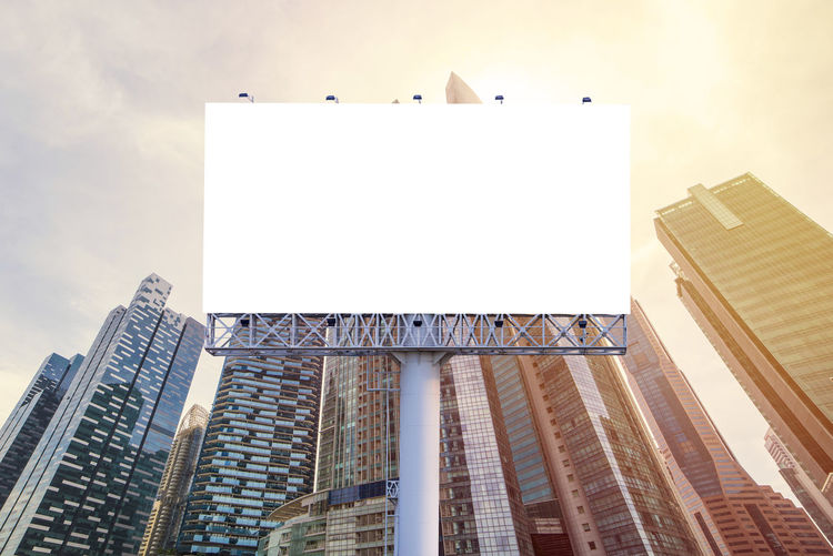 Advertisement Architecture Billboard Blank Building Building Exterior Built Structure City Communication Copy Space Financial District  Low Angle View Marketing Message Modern Nature No People Office Office Building Exterior Outdoors Sign Sky Skyscraper Tall - High