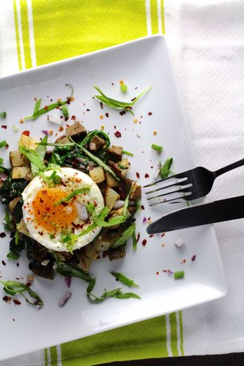 High angle view of egg and salad in plate on table