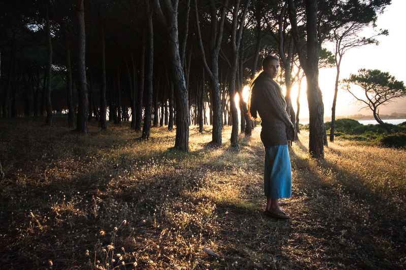 Woman standing in a forest at sunset Forest Girl Grass Light Nature One Person Outdoors Sardinia Sun Sunset Trees Woman Lost In The Landscape