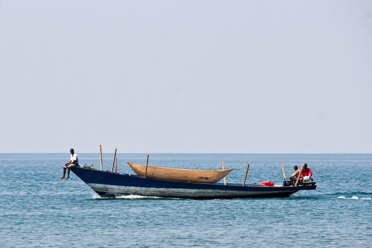 Adult Adults Only Clear Sky Day Fisherman Gondola - Traditional Boat Horizon Over Water Matema Beach Men Nature Nautical Vessel Oar Occupation Only Men Outdoors People Sailing Sea Sky Transportation Two People Water