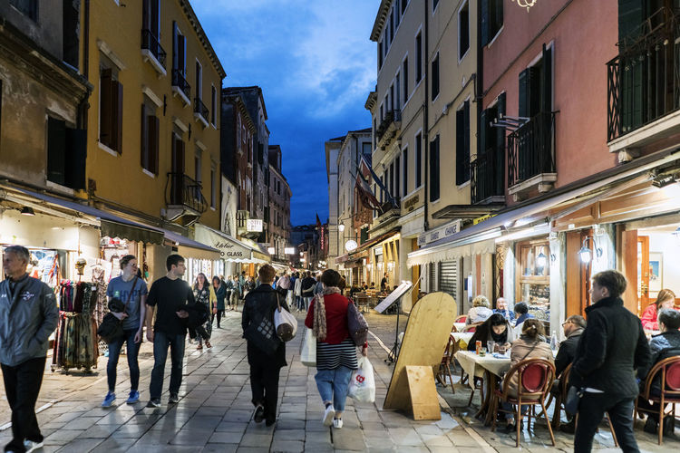 Walking along the narrow streets and canals of Venice, Italy Adult Architecture Building Exterior Built Structure Canal City Day Europe Gondola Illuminated Italy, Landmarkbuildings Large Group Of People Men Outdoors People Real People Sky Travel Destinations Venetian Venice, Italy Walking Women
