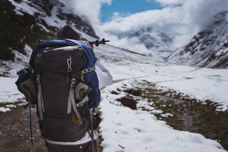 Hiking in snowy mountains Outdoor Backpack Backpack Backpacker Backpacking Roaming Wandering Nature Outdoors Live Authentic Hiking Winter Snow Cold Temperature Rear View Backpack Mountain Nature Adventure Real People Hiking Leisure Activity Frozen Day Outdoors Sky Warm Clothing Scenics Sport One Person Landscape Shades Of Winter The Traveler - 2018 EyeEm Awards