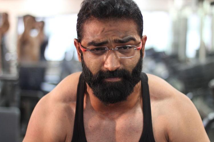 Portrait of bearded man in gym