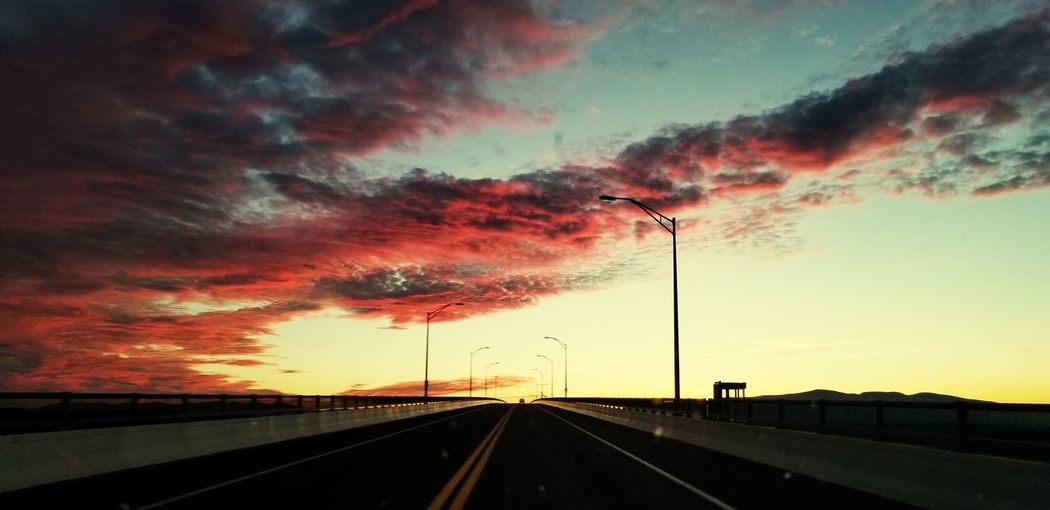 Road against dramatic sky during sunset
