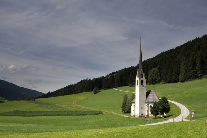 Saint Magdalina church near Villabassa in the Italian Dolomites Beauty In Nature Day Grass Green Color Mountain Nature No People Outdoors Scenics Sky