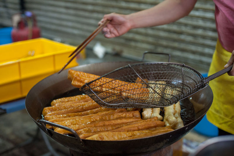 Barbecue Cakoi Close-up Day Focus On Foreground Food Food And Drink Freshness Hand Heat - Temperature Holding Household Equipment Human Body Part Human Hand Kitchen Utensil Meat One Person Outdoors Preparation  Preparing Food Real People
