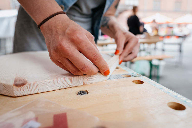 workshop project, creating with wooden material DIY Wood Wooden-material Working Workshop Art And Craft Close-up Craft Craftsperson Finger Hand Holding Human Body Part Human Hand Real People Table Wood - Material Working Workshop