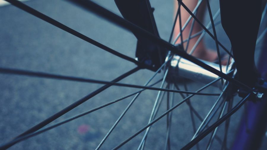 Full Frame Shot Of Bicycle Spoke On Road