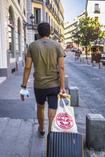 Rear view of man walking on street