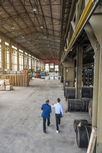 Rear view of people walking in building