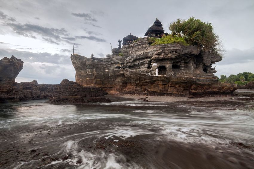 Holiday in Bali, Indonesia - Tanah Lot Temple in Denpasar Bali Bali, Indonesia Balinese Day Denpasar Heritage Hindu Hinduism Holy Indian Indian Ocean Land Sea Outdoors Pura Lot Pura Tanah Lot Religion Rock Rock Formation Tanah Tanah Lot Tanah Lot Temple Tanahlot Tanahlot, Bali, Indonesia Temple
