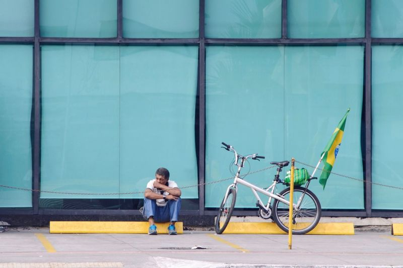 Brazil x Belgium Simplicity Flag World Cup Streetphotography Street Photography Urban Urban Geometry Colorful City Life One Person Full Length City Transportation Architecture Casual Clothing World Cup 2018 Bicycle Day Lifestyles Front View Wall - Building Feature Architecture Looking Building Exterior Emotion Sitting The Street Photographer - 2018 EyeEm Awards The Street Photographer - 2018 EyeEm Awards The Photojournalist - 2018 EyeEm Awards The Still Life Photographer - 2018 EyeEm Awards Love The Game #urbanana: The Urban Playground A New Beginning Streetwise Photography The Art Of Street Photography