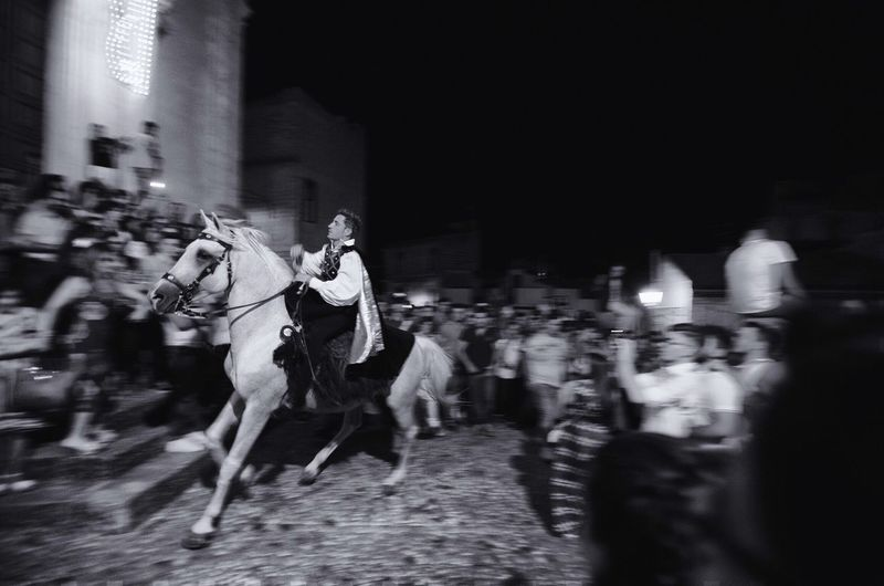 People riding horse at night