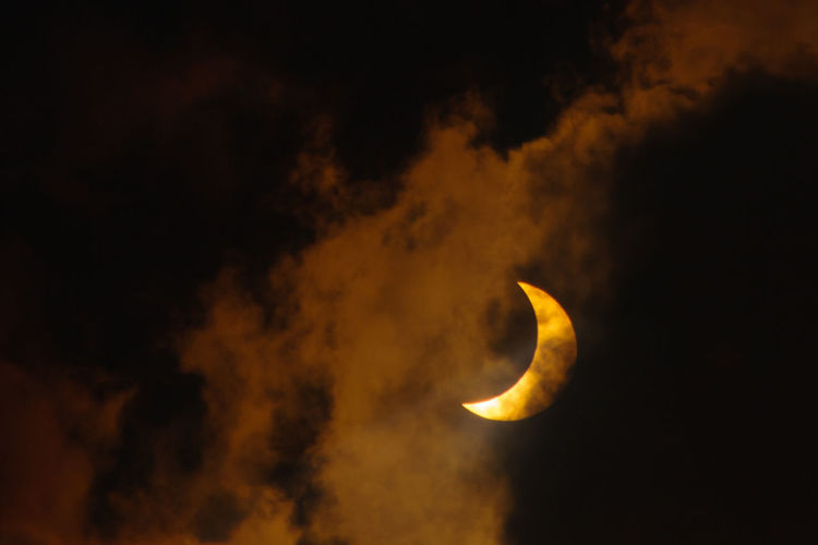 Close-up of yellow moon at night