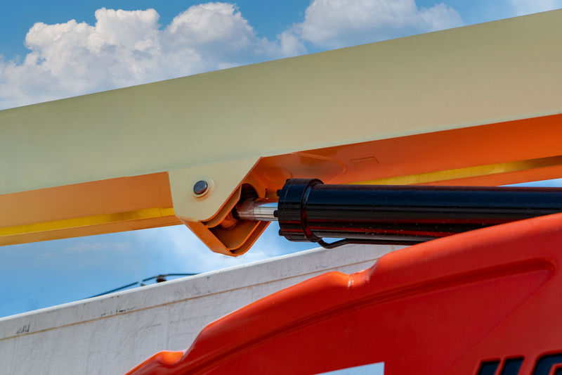 Low angle view of orange roof against sky