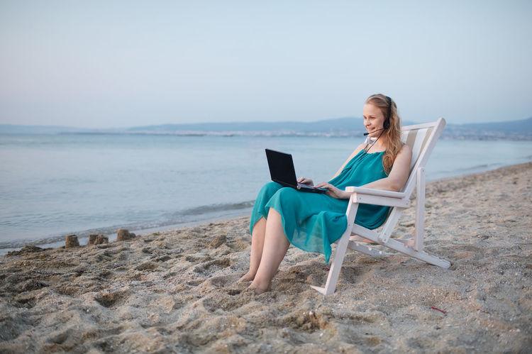 Adult Beach Caucasian Chat Communication Computer Female Girl Laptop Ocean Outdoor Outdoors Sea Skype Technology Water Woman Women