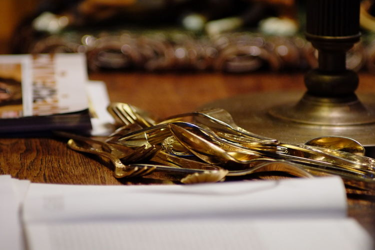 Close-up of silverware on table