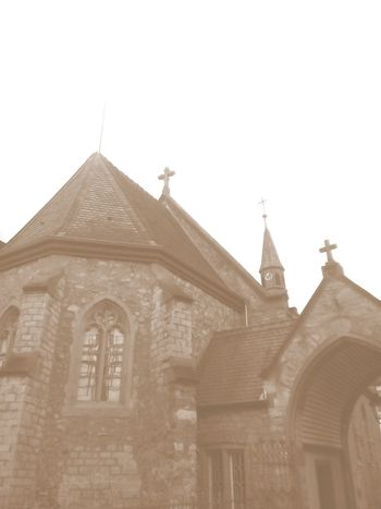 Architecture Building Exterior Built Structure Crosses Day Kirche Kreuze Low Angle View No People Outdoors Place Of Worship Place Of Worship Religion Sky Spirituality Towers Rooftop Dreamy Sepia_collection Creepy House Old Building