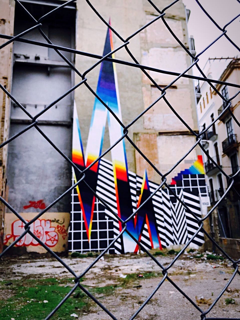 architecture, building exterior, multi colored, built structure, day, outdoors, no people, city
