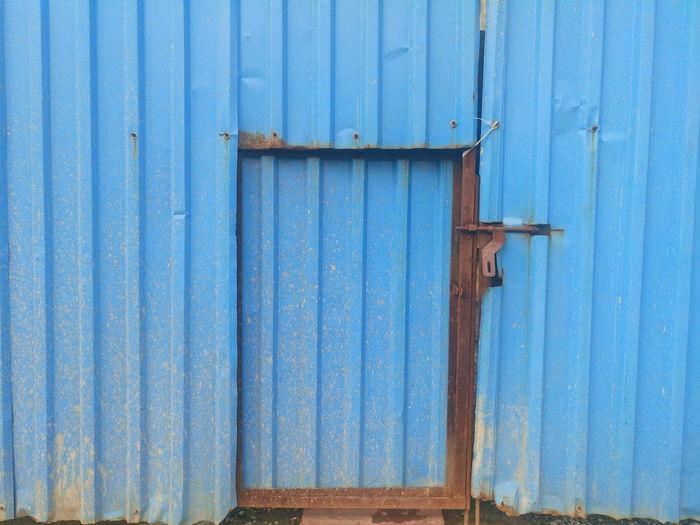 View of blue door in building
