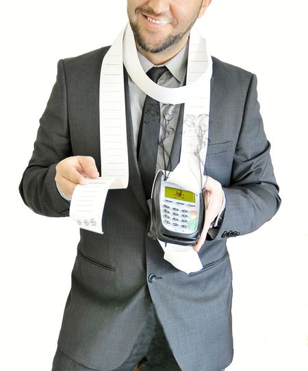 Midsection Of Businessman With Bill And Card Reader Standing Against White Background