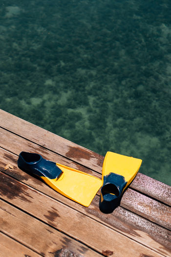 Water sports Wood - Material High Angle View No People Yellow Nautical Vessel Water Mode Of Transportation Transportation Day Lake Nature Outdoors Table Still Life Moored Pier Oar Focus On Foreground Jetty Floating On Water