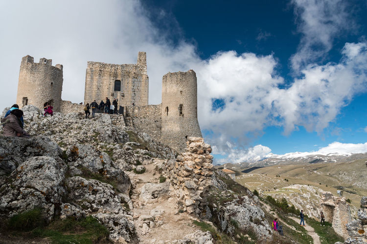 Low angle view of castle against cloudy sky