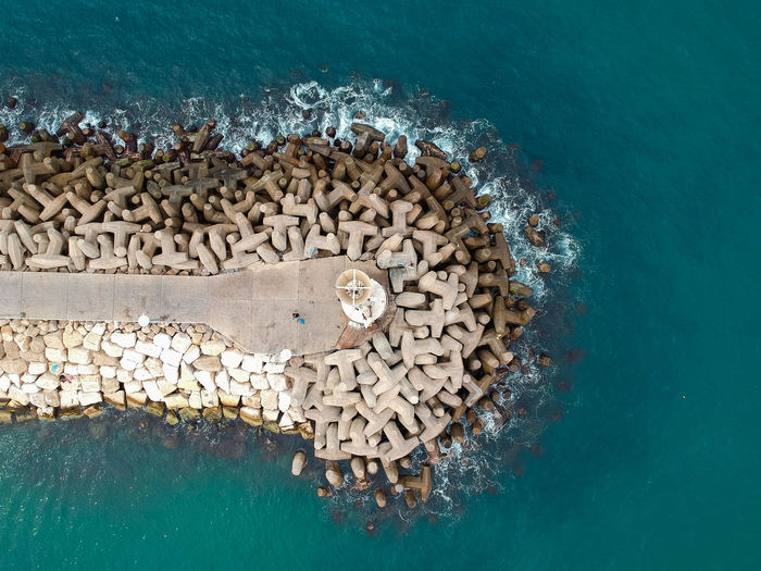 Lighthouse Drone  Waves Water Sea Nature High Angle View Solid No People Rock Day Underwater Outdoors Animal Animals In The Wild Rock - Object Animal Themes Beauty In Nature Sea Life Land Beach Marine Turquoise Colored Ashkelon Israel First Eyeem Photo