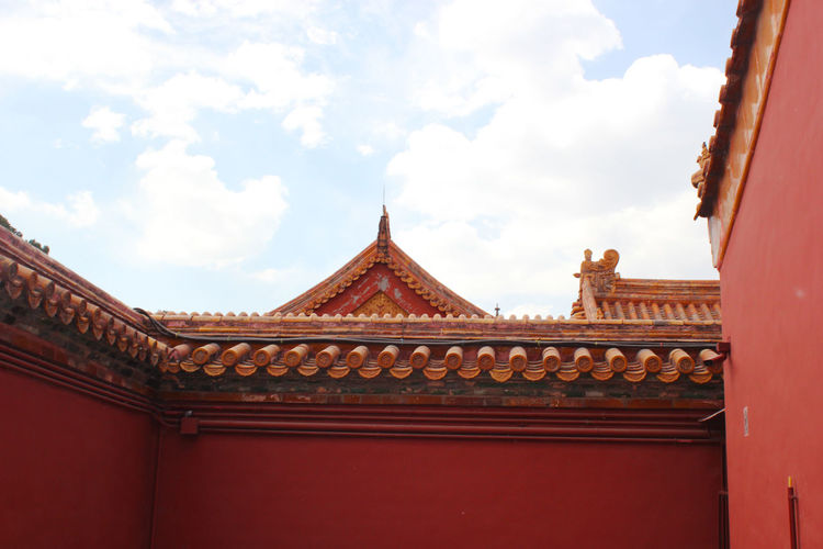 Forbidden City Architecture Belief Building Building Exterior Built Structure Cloud - Sky Contrasting Colors Day Forbidden City, Beijing, China History Low Angle View Nature No People Oriental Style Ornate Outdoors Place Of Worship Red Religion Roof Roof Tile Sky The Past Travel Destinations The Traveler - 2019 EyeEm Awards