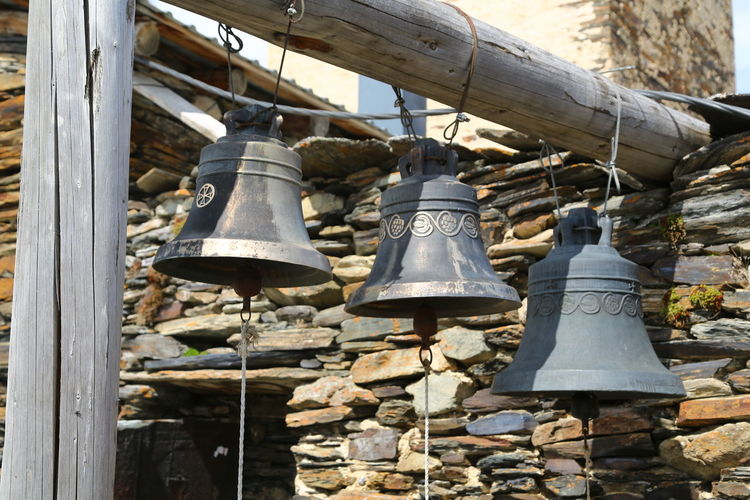 Bell Day No People Hanging Metal Outdoors Lighting Equipment Architecture Choice Wood - Material Large Group Of Objects Sunlight Nature Variation Old Built Structure Tree Close-up Place Of Worship Electric Lamp Georgia Mestia/town In Svaneti/Georgia