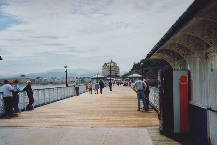 Sea Film Photography Beauty In Nature Beach Life Seaside Nautical Equipment Seashore Harbor Pier Seaside Pier Llandudno Day Full Length Built Structure Architecture Sky People Travel Destinations Outdoors Large Group Of People