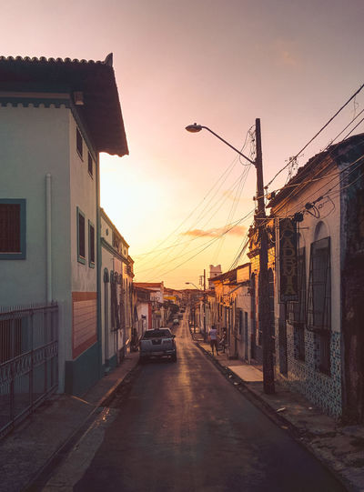 The beautiful narrow alleys of Sao Luis. Architecture Building Exterior Built Structure Cable City Dark Darkness And Light Dusk House Moody Outdoors People Reflection Residential Building Road Sky Street Streetphotography Sunset Telephone Line Transportation Travel Travel Destinations Travel Photography Traveling The Street Photographer - 2017 EyeEm Awards The Architect - 2017 EyeEm Awards EyeEmNewHere EyeEm Selects Sommergefühle Adventures In The City This Is Latin America The Street Photographer - 2018 EyeEm Awards Capture Tomorrow Skate Photography: Same Tricks, New Perspectives