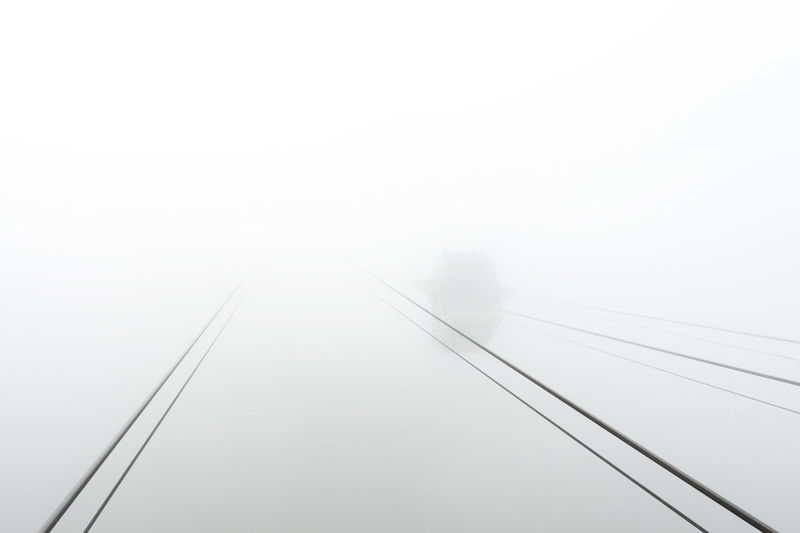 CabriO Stanserhorn Cable Railway Cabrio Stanserhorn Luzern Schweiz Standseilbahn Stanserhorn Cable Connection Copy Space Diminishing Perspective Direction Electricity  Fog Mode Of Transportation No People Outdoors Sky Switzerland The Way Forward Tourismus Transportation