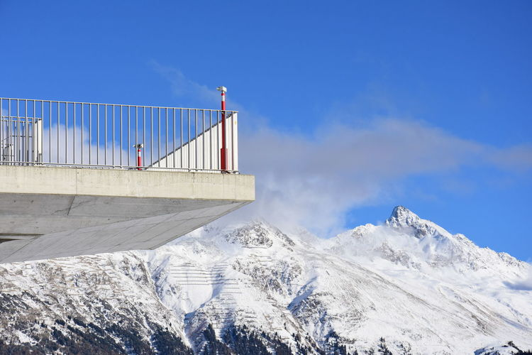 Low Angle View Of Observation Point And Snowcapped Mountains Against Sky