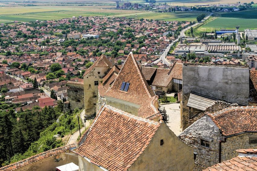 Romania Râșnov Aerial View Architecture Beauty In Nature Building Exterior Built Structure City Cityscape Day High Angle View History Medieval Architecture Medieval Castle No People Outdoors Relic Sky Town Travel Destinations