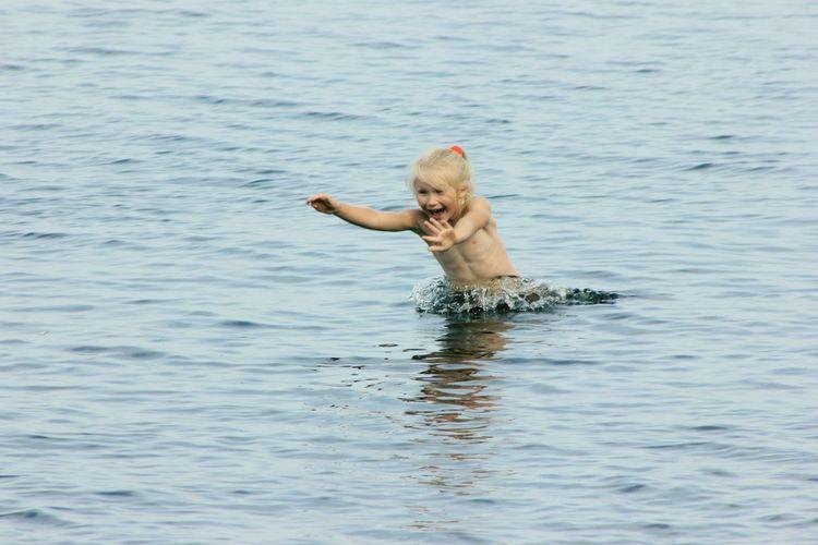 Girl Enjoying In Lake