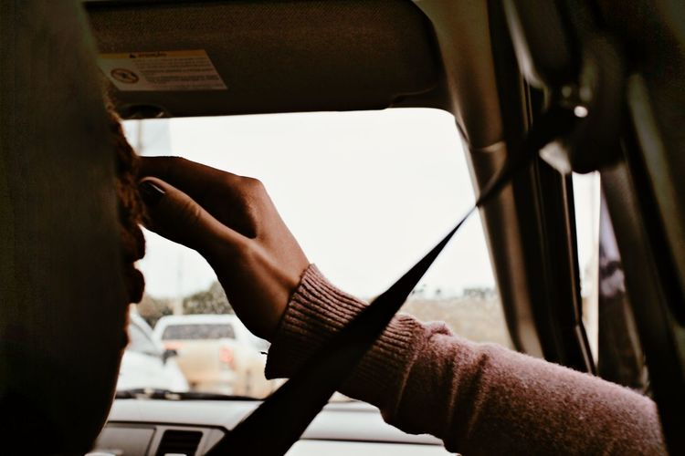 Close-up of woman sitting in car