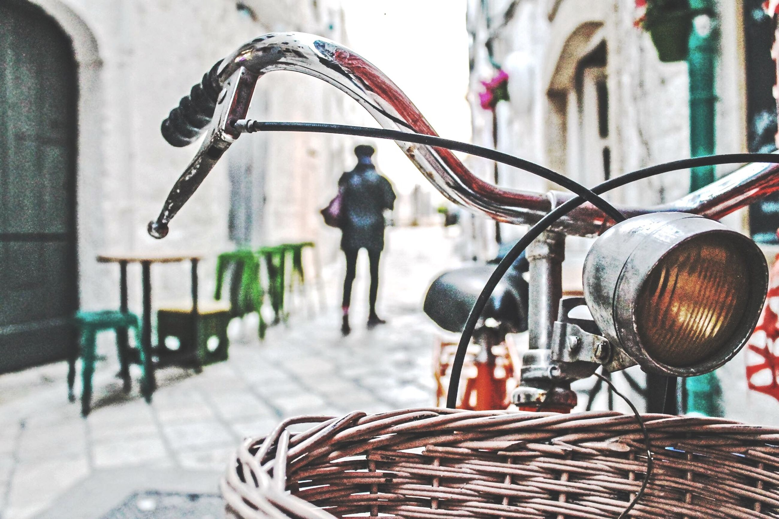 bicycle, land vehicle, metal, focus on foreground, mode of transport, transportation, men, day, indoors, street, technology, stationary, rear view, incidental people, built structure, equipment, close-up