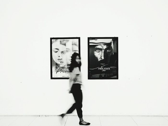 Young woman standing in front of wall