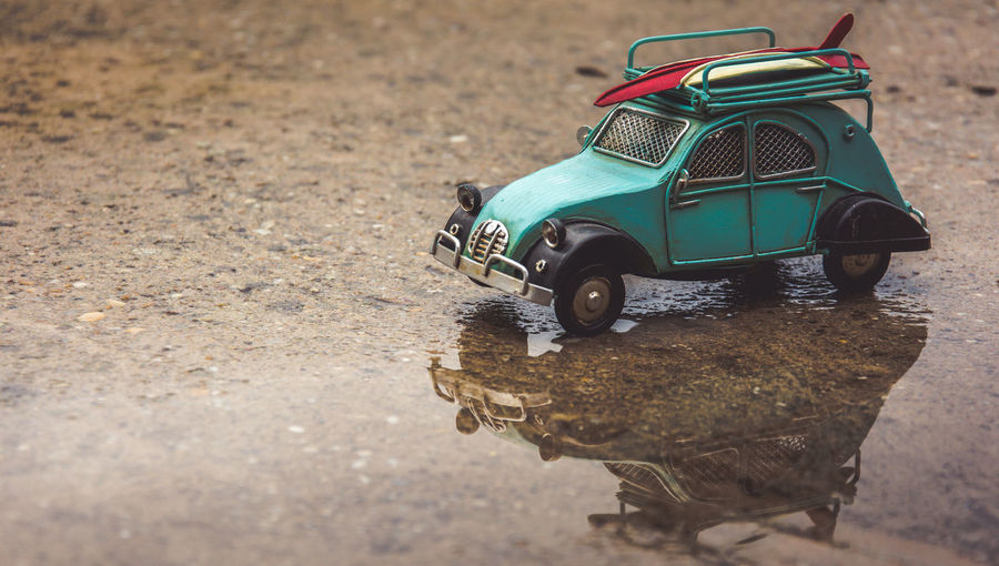 Toy car on wet ground