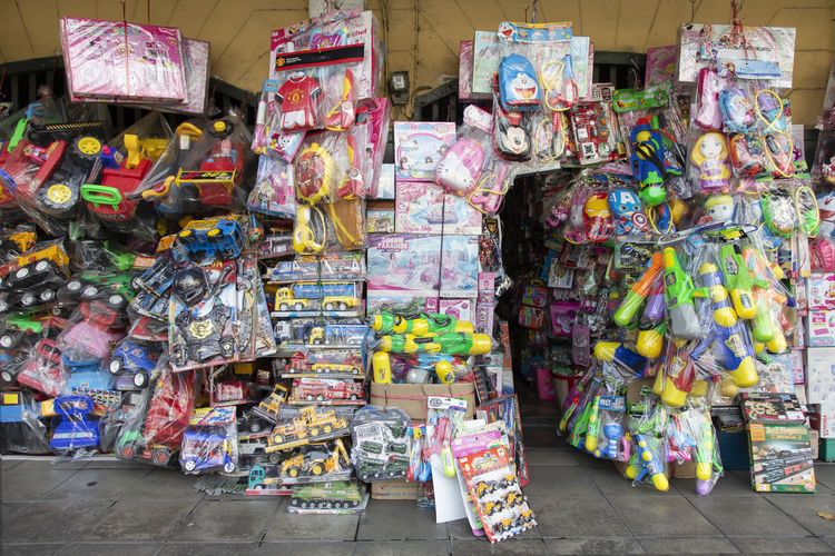 Bangkok, Thailand - April 10 2019: Colorful plastic water guns and toy for street sell for Songkran Festival water fights (13-15 April). Large Group Of Objects Multi Colored Retail  Choice Abundance Variation For Sale Small Business Market No People Day Retail Display Business Shopping Store Outdoors Collection City Hanging Street Sale Consumerism Plastic Bag Songkran Festival Bangkok