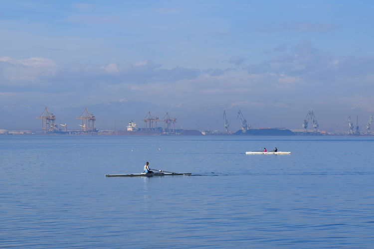Business Finance And Industry Cloud - Sky Crane Day Double Sculls Greece Mountain Nature Nautical Vessel No People Outdoors Port Sailing Sea Ship Single Scull Sky Snow Sport Thessaloniki Transportation Travel Destinations Water