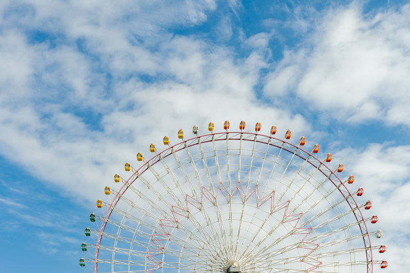 Colorful ferris wheel with beautiful clear sky, Osaka, Japan. BIG Circle OSAKA Amusement Park Amusement Park Ride Close Up Cloud - Sky Colorful Day Ferris Wheel Large Group Of People Low Angle View No People Outdoors Sky
