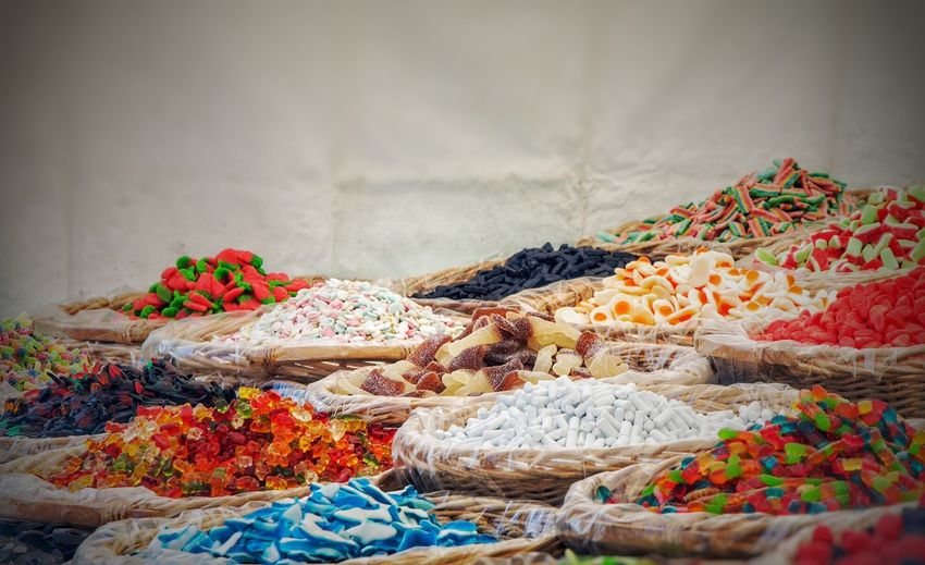 Multi colored candies for sale in market