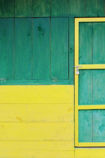 Full frame shot of wooden door on wall