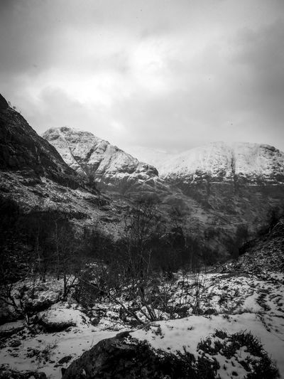 Beauty In Nature Bleak Day Glencoe Mountains Nature No People Outdoors Scotland Scottish Highlands Snow Valley Wilderness Winter