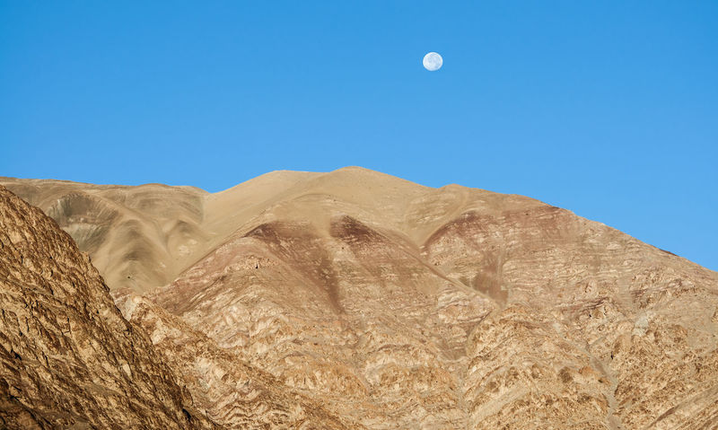Desert With Moon Rising, The Drive To Leh, Kashmir Desert Kashmir Kashmir , India Remote Location Travelling Arid Climate Astronomy Beauty In Nature Blue Clear Sky Dry Landscape Leh Leh Ladakh.. Moon Mountain Outdoors Sky Srinagar Kashmir Tranquil Scene